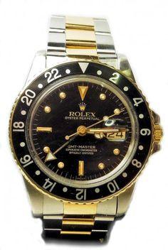 A golden&black Rolex watch