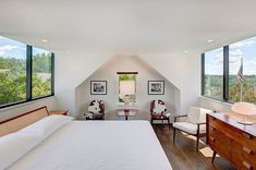 Large windows bring ample light into the new attic level master suite