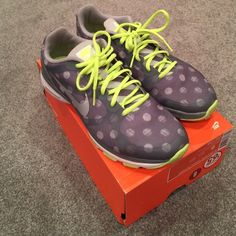 Nike dual fushion sneakers Worn mainly inside at the gym and Zumba class. Great condition. Grey with polka dots and neon laces Nike Shoes Athletic Shoes