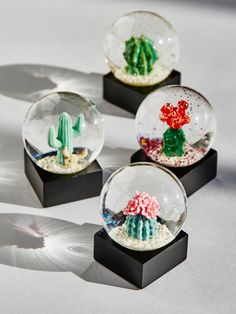 Mini Cacti Snow Globe (Set of 4) | Channel desert vibes throughout the holiday season with this set of four mini glass snowglobes, perfect for decorating any space. Each one features an ultra cute cactus.