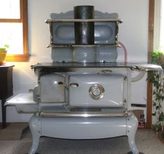 1915 antique wood cooking stove. Buck Walter Stove Company made by Continental Stove Company