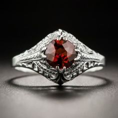 Crisply die-struck and hand-finished in gleaming 14K white gold, circa 1920s-30s, this refined, neoclassical solitaire ring glistens and gleams solo with a bright round faceted almondine garnet weighing approximately 1.00 carat. A distinctive diamond engagement ring alternative, or a just-for-fun vintage bauble. Currently ring size 6 1/2.