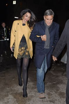 Amal Clooney in a camel coat, tights, and lace-up heels