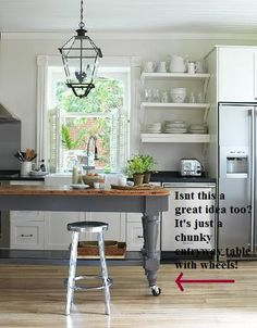 Painted chunky table + casters = unique kitchen island: could also be raised to desired height via simple platform riser.