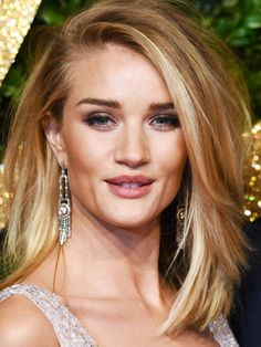 Rosie Huntington-Whiteley's long layers are styled into a side part