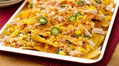 Easy Chicken Ten Minute Nachos - These nachos are the perfect way to use leftovers! We've provided a suggestion, but simply use what you have on hand; then top with some fresh additions after baking. The perfect quick dinner that everyone will love! Mexican Dishes, Mexican Food Recipes, Ethnic Recipes, Mexican Meals, Quesadillas, Appetizer Recipes, Dinner Recipes, Appetizers, Dinner Ideas