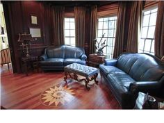 Love those hard wood floors and the intricate detail! Great dark woods accented throughout this room make it relaxing. Check out the rest of this Mt. Pleasant home and click here!