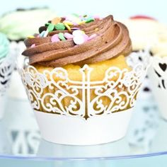 White cross design paper cupcake wrappers/holder