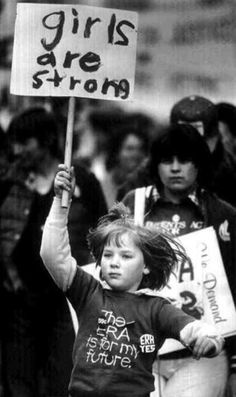 "One of my favorite pictures is this photo of a young protester carrying a ""girls are strong"" sign. This photo was taken during an ERA march demanding equal rights for women in Tacoma, WA, 1982. Perhaps I like it because the girl seems to be skipping (or running) with a determined look on her face. With a sign that appears to have been written by her and a shirt stating ""The ERA is for my future"" she is, in some ways, a symbolic reminder that fighting for civil rights, whether it's based on gende"