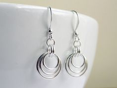 Chainmaille earrings silver - graduating hoops loops circles. $13.00, via Etsy.