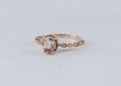 Rose Gold ring with an Oval Morganite and Diamonds on shank. Shank, Gold Rings, Bands, Diamonds, Wedding Rings, Rose Gold, Engagement Rings, Jewelry, Enagement Rings