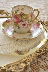 Pretty Shabby Chic Tea Cups displayed on a Mirrored Tray with Doily for a Tea Party