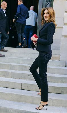 Carla Bruni spotted on the street at Paris Fashion Week. Photographed by Phil Oh.