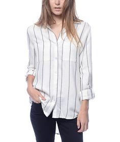 This super soft and swanky, long striped shirt gives you a classy look while still providing the fashion forward loose button up style.