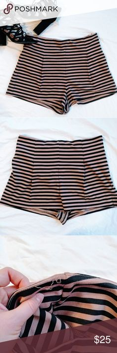 {Free People} High Waisted Striped Knit Shorts •High Rise Striped Ponte Knit Shorts •Tan & Black Striped •Front Pleats •Zipper on side  •Condition: 1 and a half inch of loose thread around waist band as seen in picture. Other than that, great. No holes or damage. Free People Shorts
