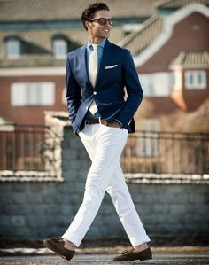 Perfect the smart casual look in a navy sportcoat and white chinos. Turn your sartorial beast mode on and go for a pair of dark brown suede tassel loafers.  Shop this look for $182:  http://lookastic.com/men/looks/blazer-and-belt-and-chinos-and-tie-and-tassel-loafers-and-dress-shirt/2163  — Navy Blazer  — Dark Brown Leather Belt  — White Chinos  — White Tie  — Dark Brown Suede Tassel Loafers  — Blue Gingham Dress Shirt