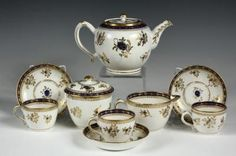 (9 PC) ENGLISH PORCELAIN TEA SET - Late 18th c. English Caughley porcelain tea set, including teapot, creamer, lidded sugar bowl, and three teacups and saucers, all in matching gold and blue decoration.