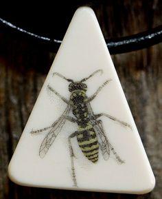 Ron Jr. hornet scrim on necklace pendant.