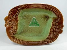 CROWN LYNN MADE IN NEW ZEALAND WHARETANA WARE NUMBER 1013 SMALL TRAY - KORURU Brown with green interior Silver foil 'Crown Lynn' Label Paper labe... Sold for $500.00 March 2016