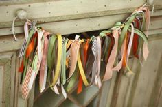 Ribbon Garland. To decorate for any season. Would be cute hung between two 3m hooks on the front door too.