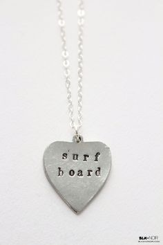 BLK AND NOIR JEWELRY - Surfboard Heart Necklace, $20.00 (http://www.blkandnoir.com/surfboard-heart-necklace/)