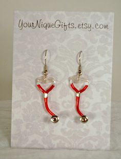 Everyone around America is buying, get yours now too!! Stethoscope Earrings. $19.95, via Etsy.