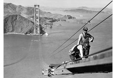 During the construction of the Golden Gate Bridge, workers endeavor to build a catwalk connecting the towers at opposite sides of the strait. This dangerous profession is portrayed with a quiet dignity by Joseph B. Strauss.