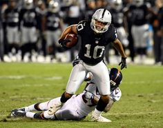 Broncos vs. Raiders:   November 6, 2016  -  30-20, Raiders  -    Oakland Raiders wide receiver Seth Roberts (10) picks up a big gain after a catch as Denver Broncos cornerback Bradley Roby (29) hauls him down during the first quarter of an NFL game at Oakland-Alameda County Coliseum on Nov. 6, 2016, in Oakland, Calif.
