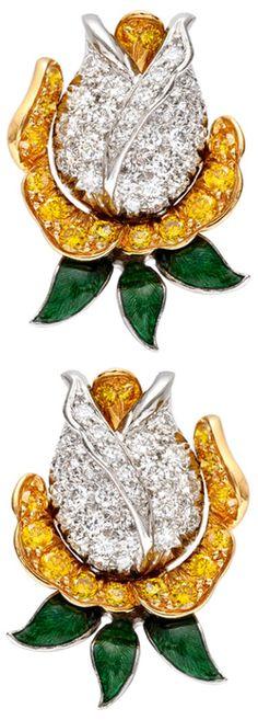 Pavé-set diamond and green enamel rosebud earclips with yellow diamond detail mounted in platinum, by Oscar Heyman.