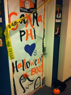 For those living in the house, have a door decorating contest for each holiday.  Here is a Gamma Phi door decorated for Halloween!