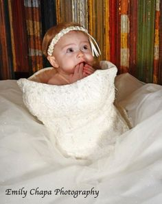 My daughter in my wedding dress and my garder on her head!