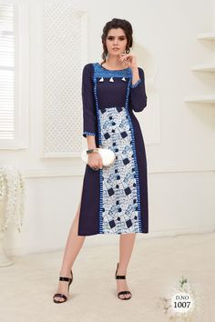 Dark-Blue-Round-Neck-Rayon-Knee-Length-Kurti-With-Pom-Pom-1007-6584 #bulk #wholesale #wholesalesupplier #wholesaledealer #bulksupplier #bulk dealer #rayon #kurti #kurta #wholesaler #stylish #printed #kurtiwholesaler #kurtiwholesalesupplier #kurtibulksupplier #kurtibulkdealr #kurtawholesaler #suratwholesaler #richlookkurtis  #latestkurtis #long #straight #officewear #dailywear #kneelength #LKFABKART Kurti Collection, Designer Collection, Churidar, Office Wear, Daily Wear, Formal Wear, Blue Dresses, Cold Shoulder Dress, Woman Clothing