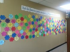 """Teacher Appreciation wall  """"Much like flowers in a garden, our teachers brighten up our school and bloom in our hearts.""""  Each flower has the name of a teacher and words that best describe them written by the children and their families."""