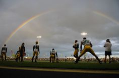 A double rainbow lingers over Green Bay Packers training camp practice at Ray Nitschke Field on Aug. 9, 2011.