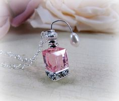 Pink perfume bottle atomizer necklace
