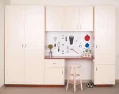 This spiffy Garage Cabinet System is complimented with Tall, Upper and Lower Cabinets, an Optional Platform, a nicely functional Laminate Workbench, and Pegboard for extra organization options. #ClosetsByDesign