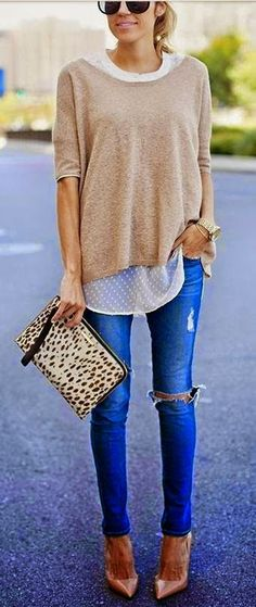 Layered tops, jeans and clutch