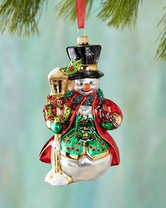 Snowman with Lantern Christmas Ornament                              …