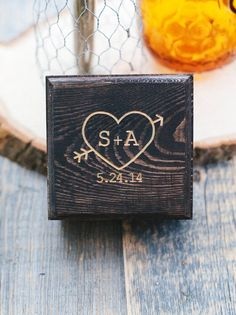 """Each customized ring box measures about 3.5""""x3.5"""". Each box is stained by hand and engraved with your initials inside a heart along with your wedding date. Also included is some floral moss to place your pretty rings on. These boxes would be perfect for a vintage, woodland, rustic, farm, eco-friendly wedding and many more events :)   If you have your own design and or idea, please contact me as I love custom orders.  Please note that wood grain may vary from box to box as these are natural…"""