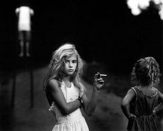 Candy Cigarette by Sally Mann (1989). Candy Cigarette, from her honest and controversial series Immediate Family, captures one of her three children, Jessie (now a model and artist), in a defiant and self-aware pose, staring down the lens at her mother, holding bubblegum cigarette.
