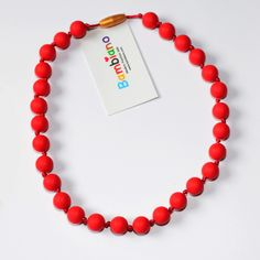 Bambiano Nicole Jr Necklace in Red. Bambiano Jr Necklaces are made of 100% Food grade silicone. BPA free, Lead free and nontoxic. Fashionable for trendy girls 3 years and above. Necklaces are colourful, washable and soft against the skin. Shop at www.bambiano.com