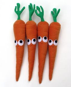 A quartet of adorable felt carrots. #felt #crafts #food #felt_food #DIY #cute #kawaii #carrots