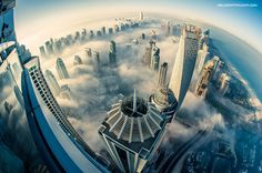 CLOUD CITY, DUBAI Photograph by Sebastian Opitz   AblazeWithLight.com Photographer Sebastian Opitz took this amazing cityscape of Dubai from the 85th floor of the Princess Tower just as a heavy fog began to roll in. The Princess Tower, located in the Marina district of Dubai, UAE, is the world's tallest residential building…