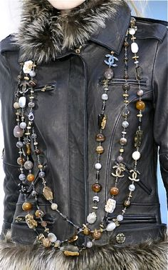 Fun Chanel............lovin' this look !!!   have to try it ou!!  jewelry outside leather......