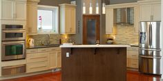 Contemporary L-shaped kitchen with pantry and island.