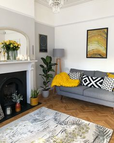 Living room with grey Farrow and Ball Dimpse on wall and fireplace, and yellow accents. Parquet floor, Wendy Morrison rug and DFS French Connection Zinc sofa.#livingroom #livingroomdecor #farrowandball #farrowandballdimpse #dimpse #greyandyellowdecor #greyandwhitedecor #greydecor #greydecorideas #zincsofa #greylivingroom