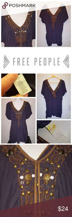 FP V-Neck Loose Boyfriend Fit Tunic Top Excellent used condition with no major wear or obvious flaws. Size Large, meant to fit loose/oversized, so will work for a Medium as well. All beading/embellishments are intact, none missing. Reasonable offers. Bundle to save $$$. Happy Poshing!  Free People Tops