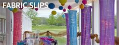 Cover columns and arches with fabric slips of different colors from Shindigz. Fabric covers are reusable, easy to store, and help streth your party decorations budget.