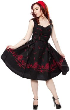 HELL BUNNY ADAIRE 50'S DRESS RED/BLK The Hell Bunny Adaire dress was made for waltzing in the moonlight! This 50s inspired dress gets a dark twist with it's cemetery scene pattern down at the bottom hem & all all raven feather pattern throughout the dress. Flattering vintage body with corset ties down each sides makes it the perfect dress for every gal's closet. $79.00 #hellbunny #vintageinspired #corset #raven