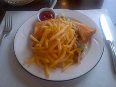 Clubsandwich 'Beefburger' made of Swiss beef, toast, salad, mayo, ketchup and onions with home-made French fries @ Restaurant Café de Ville